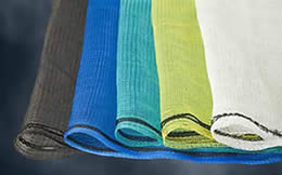 Scaffold netting of different colors: yellow, black, blue, white and green.