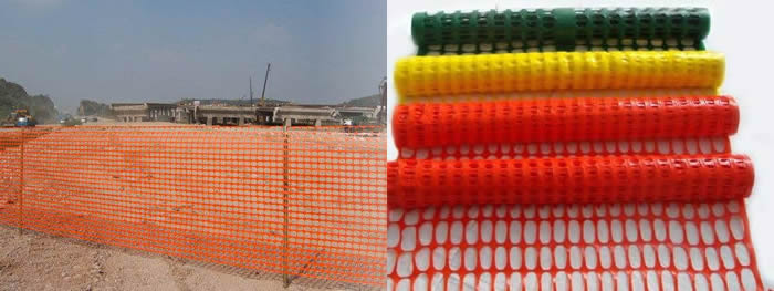 The orange safety barrier fence is installed in the construction site.