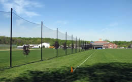 The black safety netting is installed on the football field.